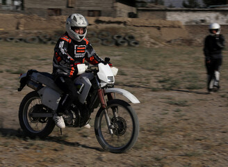 Negin Afshar, 16, one of the motocross racers is seen during a training in Kabul