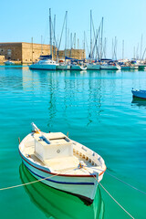 Fishing boat in the harbour near Koules Fortress in Heraklion