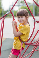 Poster de jardin Doux monstres cute 6 years old girl on the playground