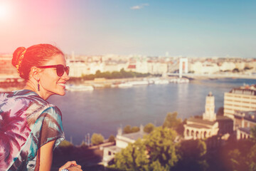 Young woman in sunset wondering in city panorama Budapest, Hungary