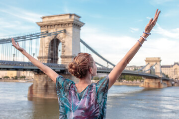 Thankful woman arms raised at Budapest, Hungary