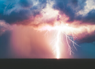Large lightning strike as seen from drone. A Florida thunder storm releases a powerful bolt of electricity from the clouds.