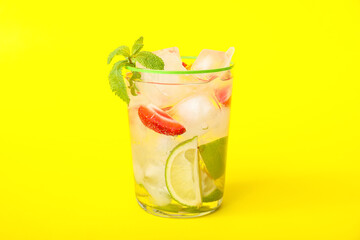 Glass of fresh strawberry lemonade on color background