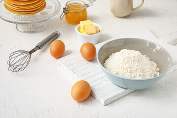 Ingredients for pancakes on white background
