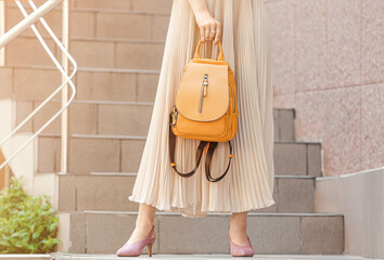 Young woman with stylish bag near shop outdoors