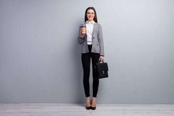 Full size photo of amazing pretty business lady young promoted chief hold diplomat takeout ht fresh coffee beverage wear specs shirt blazer pants high-heels isolated grey color background