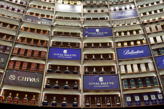 Singapore, Singapore – January 16, 2018. Rows of Royal Salute, Chivas and Ballantines whisky bottles in shop
