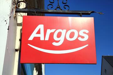 Carmarthen, Wales, UK – January 2, 2017:  Argos logo advertising sign outside its retail supermarket stores in the city centre