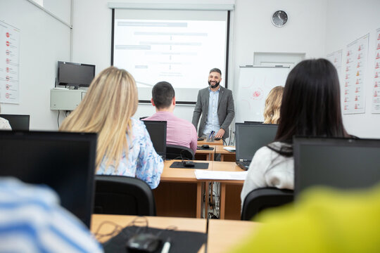 University professor lecturing small group of students