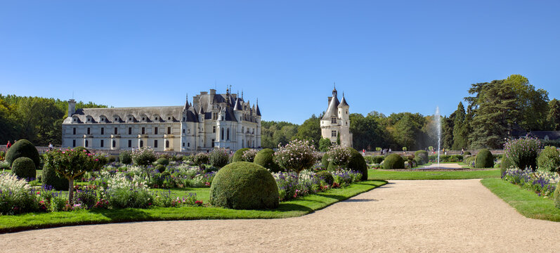 Chenonceau, France - September 18 2019: Panoramic of the Chateau de Chenonceau in the Loire Valley with garden of Diane de Poitiers in foreground