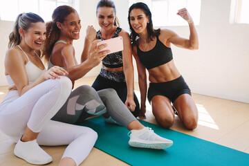 Women enjoying selfie after workout