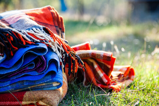 Pile of blankets on grass in winter for outdoor picnic