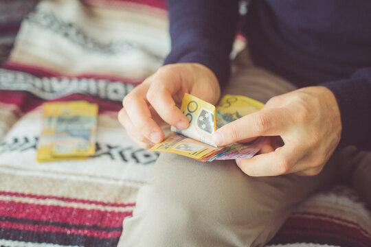 Man Counting 50 Dollar Notes