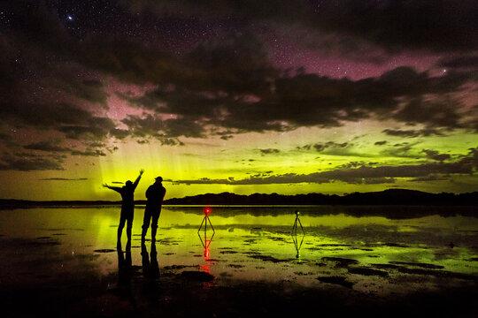 two photographers shooting aurora australis