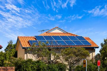 Large solar panels on suburban rooftop
