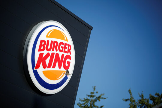 The Burger King company logo stands on a sign outside a restaurant in Bretigny-sur-Orge, near Paris