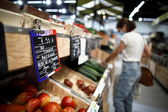 A customer shops for vegetables at a Naturalia organic foods grocery store operated by Casino Group, in Bretigny-sur-Orge