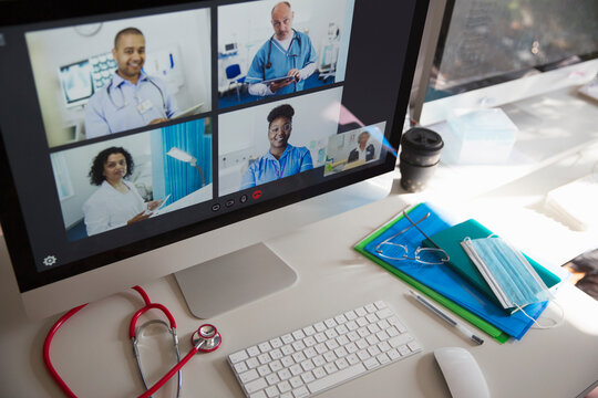 Doctors and nurse video conferencing on computer screen
