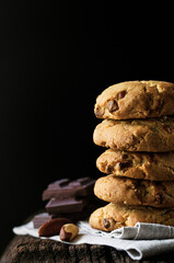 Stack of chocolate chip cookies with Brazil nuts