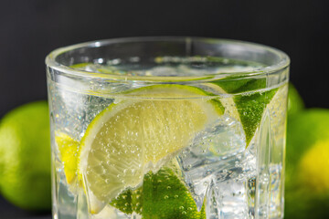 Lime slice with a sparkling water in a glass. Summer drink concept.