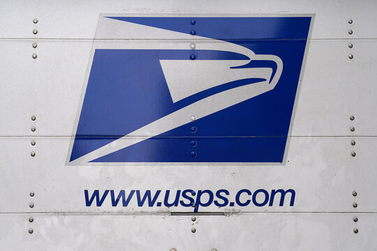 USPS eagle logo is pictured on a truck in Manhattan, New York City
