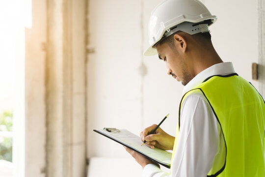 Builder inspection consultancy. Inspector checking material and structure in construction.