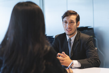 HR manager interviewing female candidate applicant who recruit job in the office.