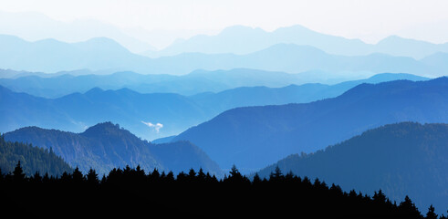 Misty view of the blue mountain range -  Beautiful landscape with cascade blue mountains at the...