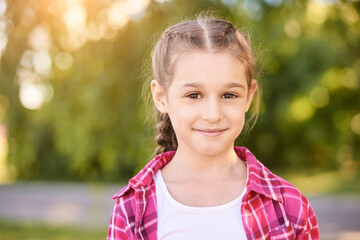Funny young girl at park. Finish lockdown. Smile spanish person. Schoolgirl portrait. Summer female portrait. Face. Attractive lifestyle. Pretty kid. Looking at camera