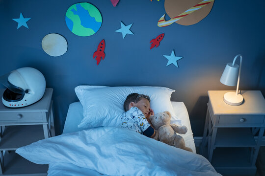 Boy sleeping and dreaming a future in the space