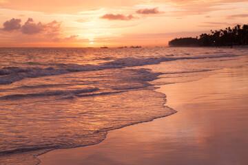 Bright sunrise over Atlantic Ocean. Bavaro beach