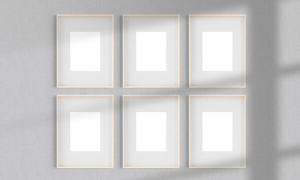 Six wooden frames on a wall