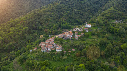 Beautiful small Italian village in mountains. aerial photo of the village of Topolò e municipality of Grimacco, in the province of Udine, region Friuli-Venezia Giulia north-eastern Italy. Small town