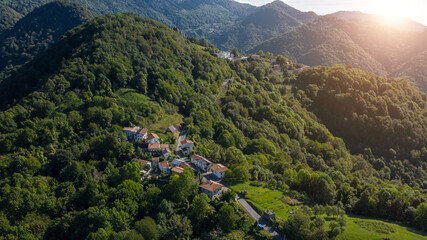 aerial photo of the village of Topolò e municipality of Grimacco, in the province of Udine, region Friuli-Venezia Giulia north-eastern Italy. Small town in the Alps mountains. Beautiful nature place