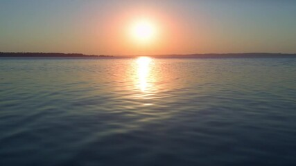 Wall Mural - Sunset in the river with calm water surface