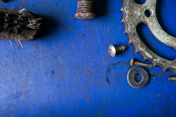 Old gears and old nut on wooden tables