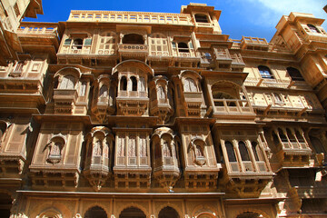 Golden city of India - wonderful Jaisalmer with carved traditional buildings in Mughal style. Rajasthan