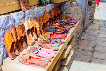 Traditional India. Shop streets in old town Jaisalmer. Handmade leather shoes. Rajasthan.