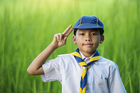 Asian boy scouts making an oath.