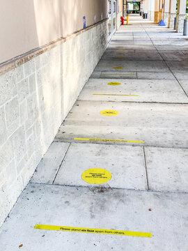 Miami, FL / USA, July 24, 2020: Best Buy store at Suniland shopping center in Pinecrest, yellow and black social distancing floor marker tape indicating to stand six 6 feet apart.  Editorial.