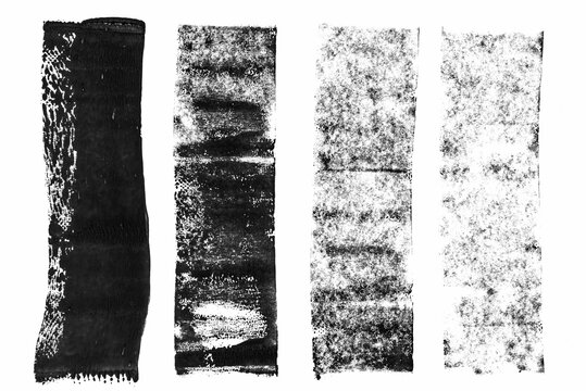 high res macro photo of black lino ink remain, linocutting paint roller texture on white paper background.
