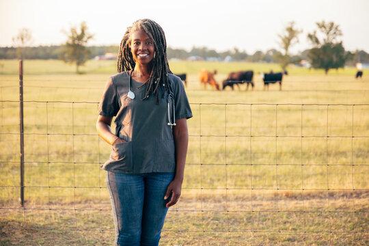 Black veterinarian on farm to check animals
