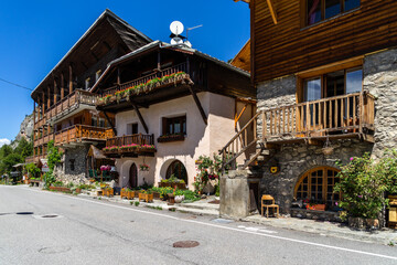 An alpine village with typical wooden houses on the road to the Col de Vars, France