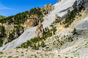 The scenic landscape of the Casse Deserte en route to the Col d'Izoard, one of the most iconic mountain pass of the Tour de France