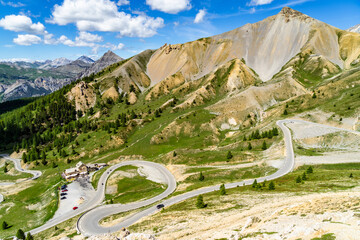 The scenic serpentine road climbing up to the Col d'Izoard (2360), one of the most famous mountain passes of the Tour de France.