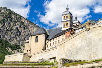 The Collegiate Church of Notre-Dame and Saint-Nicolas overlooking Briancon city walls, Huates Alpes, France