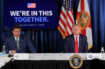 """U.S. President Donald Trump holds a """"COVID-19 Response and Storm Preparedness"""" event at the Pelican Golf Club in Belleair, Florida"""