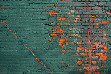 old vibrant painted brick wall background with exposed red painted bricks
