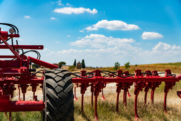 Modern agricultural machinery and equipment. Industrial details in Tuscany landscape, Italy