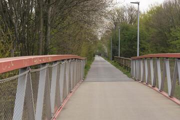Cyclists ride along bike path